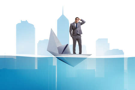 Businessman escaping sunken paper boat ship Stock Photo