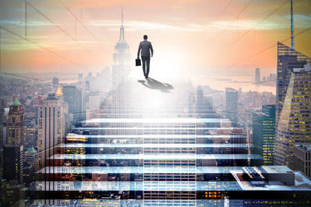 Businessman climbing up challenging career ladder in business co
