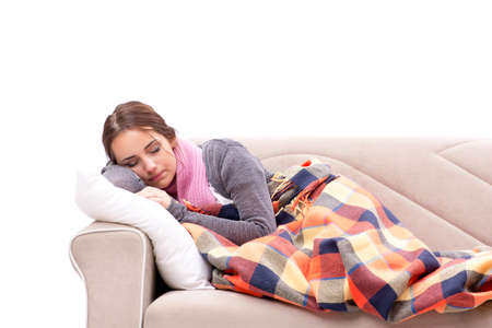 Teenager suffering from cold sitting on couch