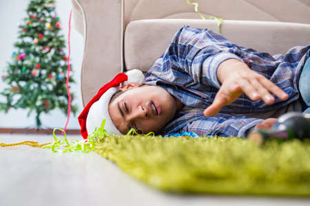 Man having hangover after christmas party