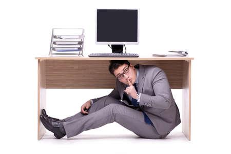 Businessman hiding in the ofice