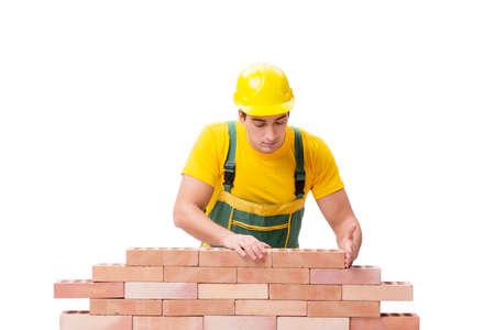 De knappe bouwvakker bouwstenen muur