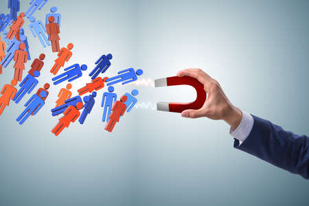 Businessman in recruitment concept with horseshoe magnet