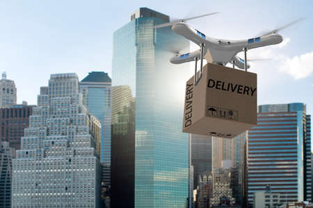 Drone delivery concept with box in air Standard-Bild