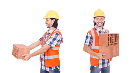 Builder with clay bricks isolated on white Stock Photo