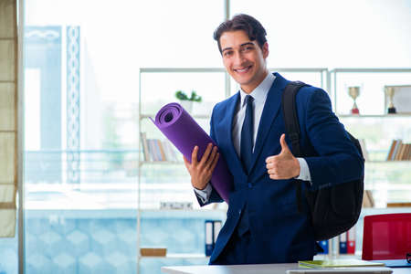 Man getting ready for sports break in the office