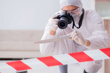 Forensic expert at crime scene doing investigation Zdjęcie Seryjne - 89782145
