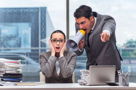 Boss yelling at his team member Stock Photo