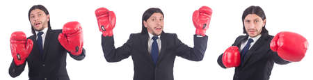 Businessman with boxing gloves on white Stock Photo - 89745861