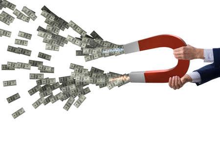 Businessman catching dollars on horseshoe magnet 版權商用圖片