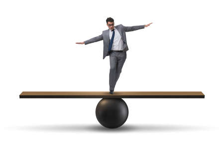 Businessman balancing on seesaw in uncertainty concept 版權商用圖片 - 90181115