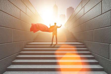 Businessman superhero pressing virtual buttons on career ladder