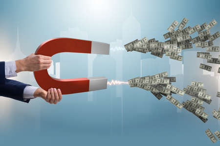 Businessman catching dollars on horseshoe magnet Banque d'images