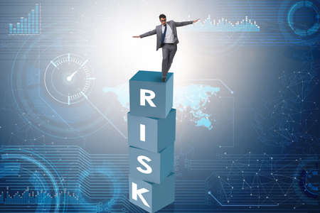 Businessman in risk and reward business concept Banque d'images