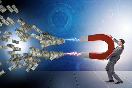 Zakenman die dollars op hoefijzermagneet vangen Stockfoto