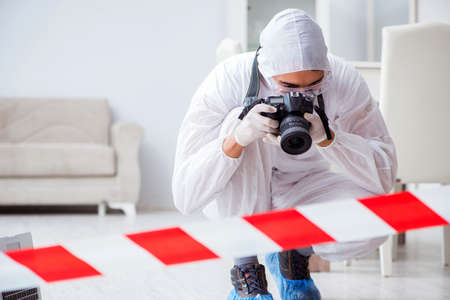 Forensic expert at crime scene doing investigation Stock Photo - 90786162