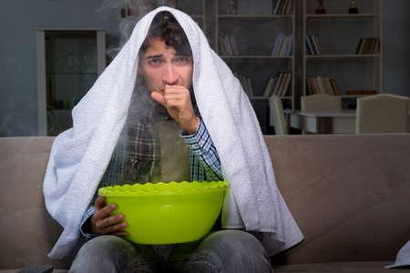 Sick man doing inhalation at night in home