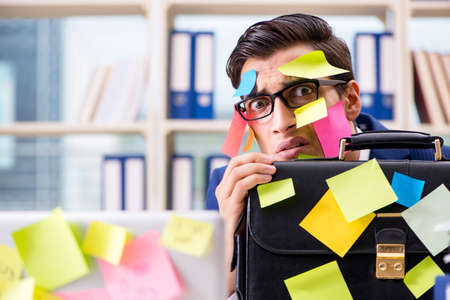 Businessman with reminder notes in multitasking concept Zdjęcie Seryjne