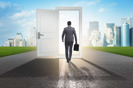Businessman in front of door in business opportunities concept Standard-Bild