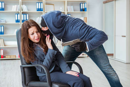Criminal taking businesswoman as hostage in office Stock fotó