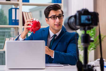 Businessman recording a video for vlog 스톡 콘텐츠