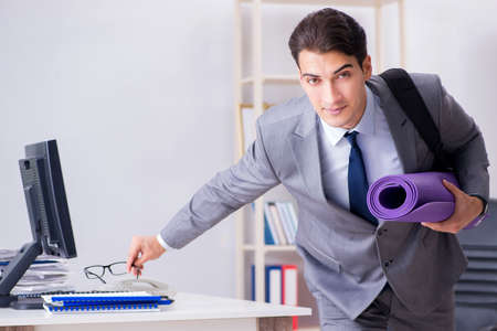 Young businessman rushing to sports gym during break Stock Photo