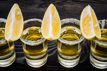 Tequila drink served in glasses with lime and salt Imagens