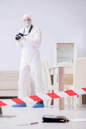 Forensic expert at crime scene doing investigation