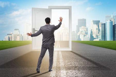 Businessman in front of door in business opportunities concept Stock Photo
