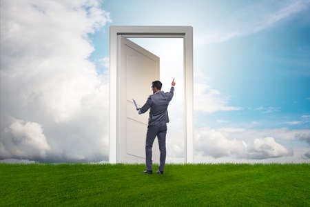 Businessman standing in front of door into future