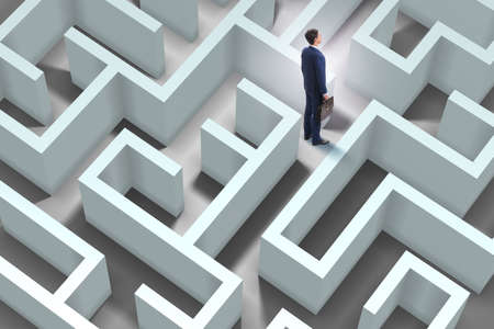 Businessman is trying to escape from maze labyrinth Banque d'images