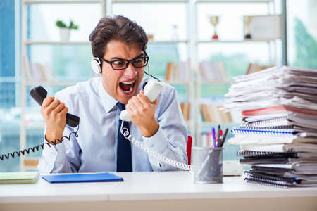 Unhappy angry call center worker frustrated with workload Stock fotó