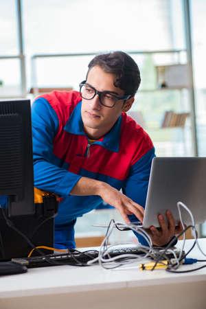 Computer repairman working on repairing computer in IT workshop Reklamní fotografie