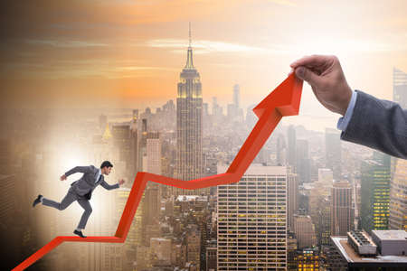 Businessman supporting growtn in economy on chart graph Stock Photo