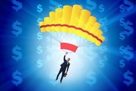 Businessman in golden parachute concept