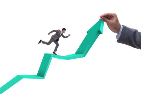 Businessman supporting growtn in economy on chart graph 免版税图像