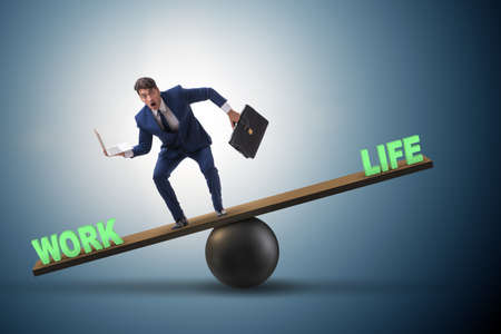 Businessman balancing between work and life in business concept