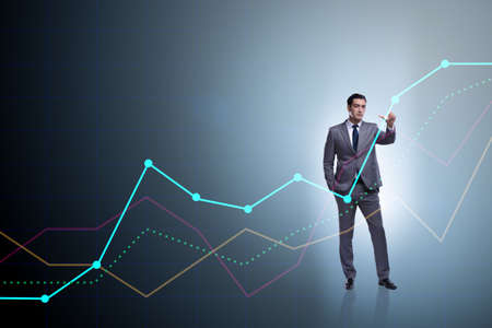 Businessman standing next to chart in business concept Stock Photo - 93616054