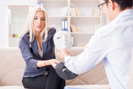 Young woman visiting psychiatrist man doctor for consultation Stock Photo