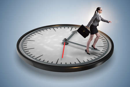 Businesswoman in time management concept Imagens