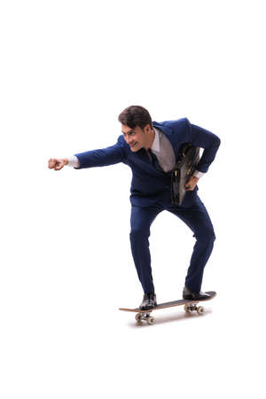 Businessman riding skateboard isolated on white background Stock Photo