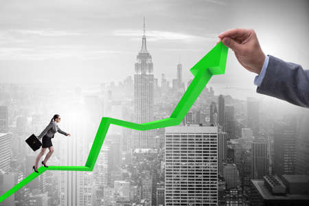 Businesswoman climbing line chart in economic recovery concept Banque d'images