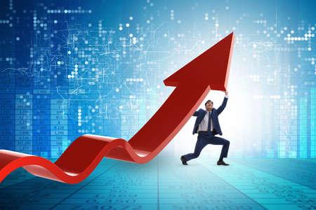 Homme d'affaires soutenant growtn en économie sur graphique