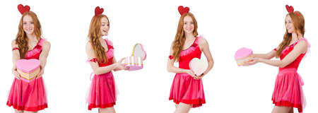 Pretty young model in mini pink dress holding gift box isolated on a white background Stock Photo