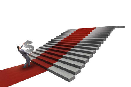 Young businessman climbing stairs and red carpet on white background Foto de archivo