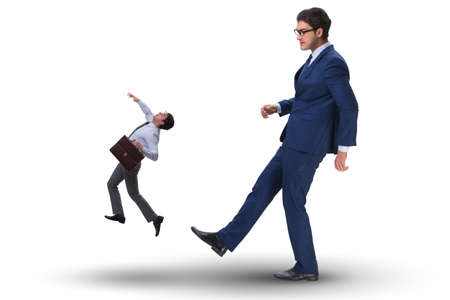 Bad angry boss kicking employee in business concept Stock Photo