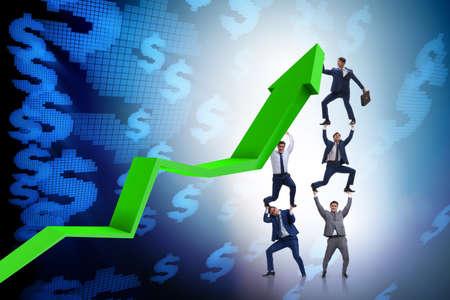 Homme d'affaires soutenant growtn en économie sur graphique Banque d'images