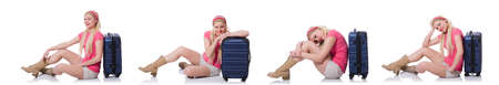 Young woman with suitcase ready for beach holiday