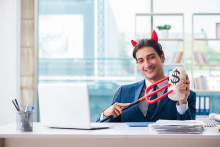 Devil angry businessman in the office Reklamní fotografie - 94964546