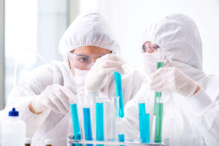 Two chemists working in the lab Stock Photo